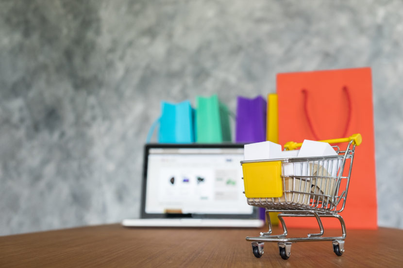 ecommerce, laptop and shopping bags, online shopping concept